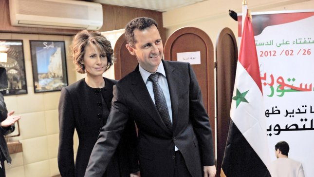 Syrian president Bashar al-Assad, with his wife Asma (L), casts a vote during a referendum on a new constitution in Damascus, Syria earlier this year. UPI