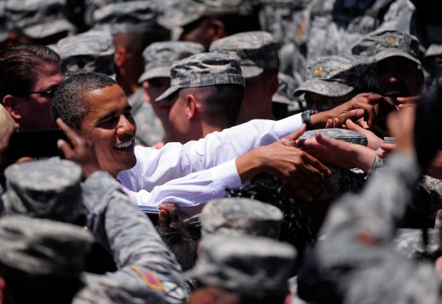 President Barack Obama meets with troops, veterans and military families after signing changes to the GI Bill at the headquarters for the Army's 3rd Infantry Division in Fort Stewart, Georgia on April 27, 2012. UPI/David Tulis