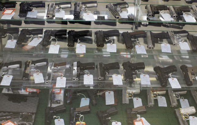 Various semiautomatic handguns are displayed in a case at G. A. T. Guns in Dundee, Illinois on June 28, 2010. UPI/Brian Kersey
