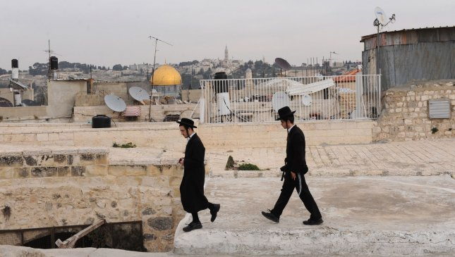 Ultra-Orthodox Jews walk on a rooftop overlooking the Dome of the Rock in the Old City of Jerusalem, January 25, 2011. Al-Jazeera released leaked documents called the Palestine Papers that reveal that Palestinian negotiators were willing to compromise on the issues of Jerusalem and refugees during peace talks with Israel in 2008. UPI/Debbie Hill