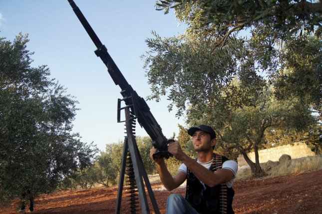 Members of the Free Syrian Army are with a weapon mounted on a vehicle, near Idlib August 31, 2012, government forces shelled a number of areas in northern Syria part of efforts by the regime to target rebel strongholds 2012 file photo UPI