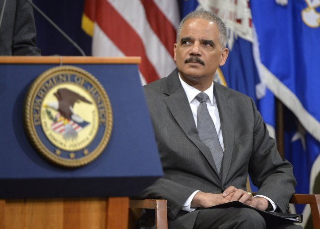 U.S. Attorney General Eric Holder attends a ceremony horning the 50th Anniversary of the signing of the Civil Rights Act and the formation of the Civil Rights Division of the Department of Justice, at the Department of Justice in Washington, D.C. on July 14, 2014. UPI/Kevin Dietsch