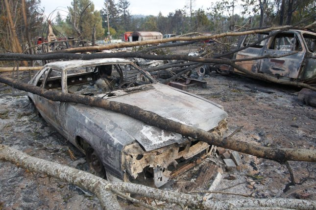 The burned remains of houses and vehicles sit destroyed by the Valley Fire on Monday in Middletown, Calif. An additional $250 million in funding was allocated to wildfire relief. Photo by Mathew Sumner/UPI