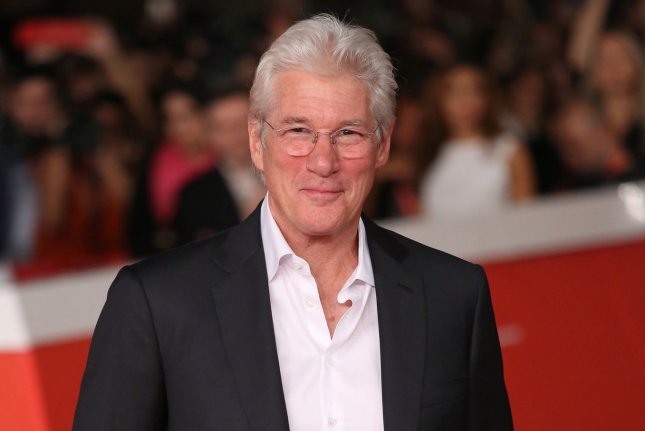 The Dinner actor Richard Gere arrives on the red carpet before the screening of the film Time out of Mind at the 9th annual Rome International Film Festival in Rome on October 19, 2014. File Photo by David Silpa/UPI