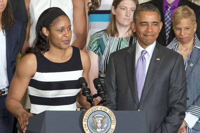Minnesota Lynx forward Maya Moore (L) makes remarks in 2014 as President Obama welcomes the WNBA champions to the East Room of the White House to honor the team. File photo by Ron Sachs/Pool/UPI