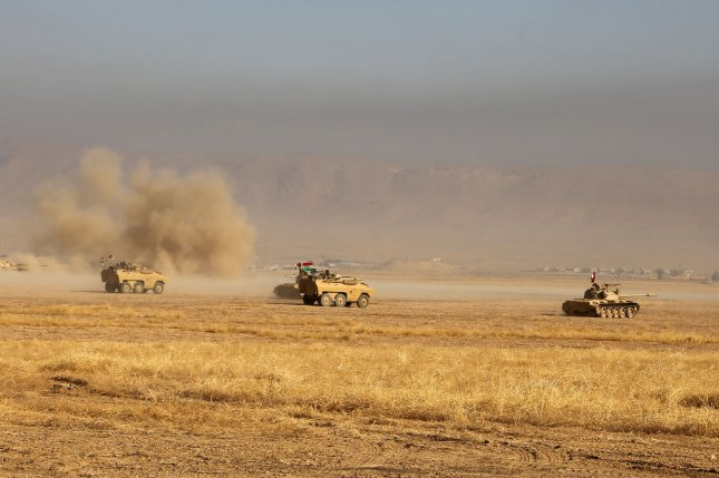Iraqi Kurdish Peshmerga fighters near Mount Zardak, east of Mosul, take part in an operation against Islamic State targets on Monday. U.S. military officials said Wednesday that the terror group's leaders have started to flee ahead of the three-pronged advance by U.S.-led coalition forces on the contested city, which has been ruled by militants for two years. File Photo by Shvan Harki/ UPI