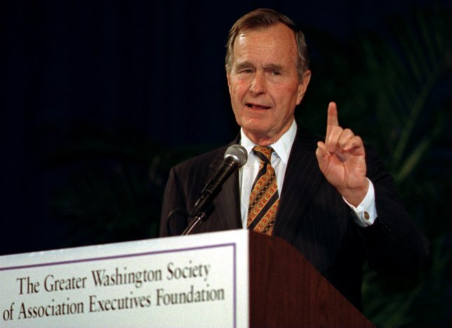 Former President George H. W. Bush discusses his 50-year partnership with wife, Barbara Bush, during an appearance January 22, 1996 at the Kennedy Center in Washington. On this day in 1993, Kuwait said it foiled an Iraqi plot to assassinate Bush during his visit earlier in the month. UPI File Photo