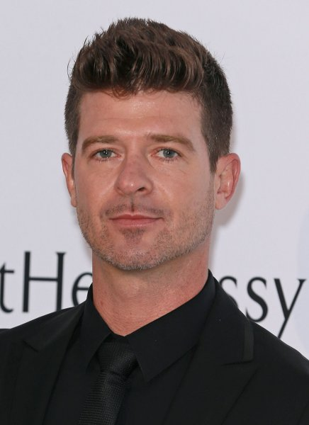 Robin Thicke arrives at the 22nd amfAR Cinema Against AIDS 2015 gala at the Hotel du Cap-Eden-Roc in Antibes, France on May 21, 2015. The singer's girlfriend is pregnant. File Photo by David Silpa/UPI
