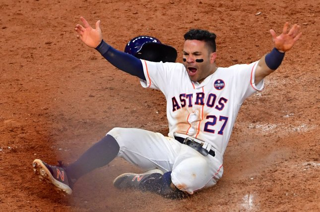 Houston Astros baserunner Jose Altuve celebrates after scoring the winning run on a double by Carlos Correa during Game 2 of the ALCS Game 2 vs. the New York Yankees. Photo by Aaron M. Sprecher/UPI