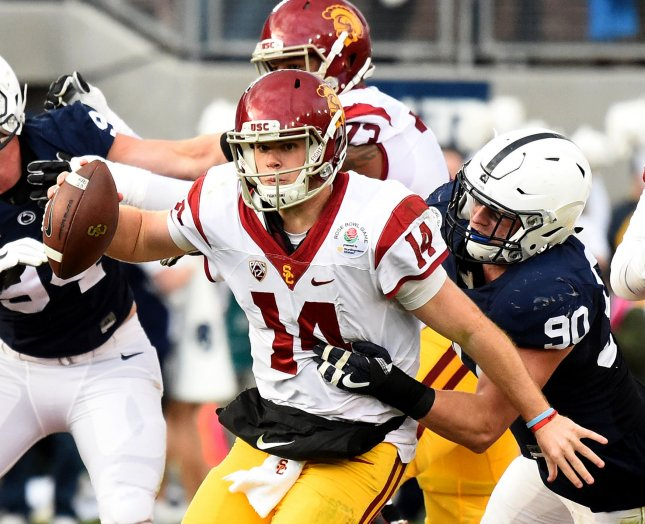 USC quarterback Sam Darnold is tackled from behind during last season's Rose Bowl against Penn State. Photo by Juan Ocampo/UPI