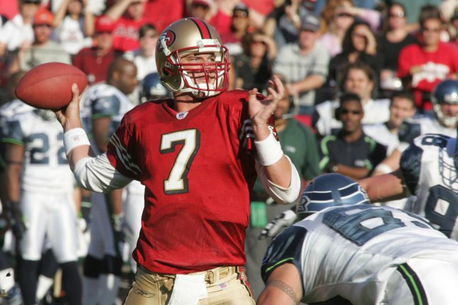 Former San Francisco 49ers quarterback and Carolina Panthers assistant coach Ken Dorsey throws under pressure from the Seattle Seahawks at Monster Park in San Francisco on November 20, 2005. File photo by Terry Schmitt/UPI