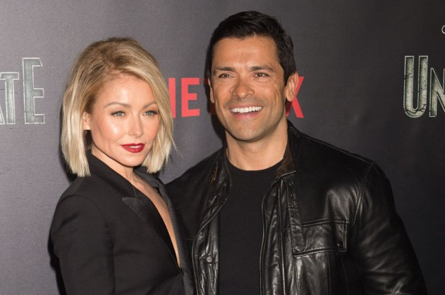 Kelly Ripa (L), pictured with Mark Consuelos, posted a slideshow of photos on the actor's 47th birthday. File Photo by Bryan R. Smith/UPI