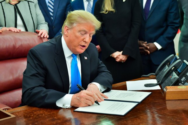 President Donald J. Trump signs the Space Policy Directive on February 19, 2019, authorizing the proposal sent to Congress on Friday by the Pentagon outlining its plans and budget to establish a Space Force. Photo by Kevin Dietsch/UPI