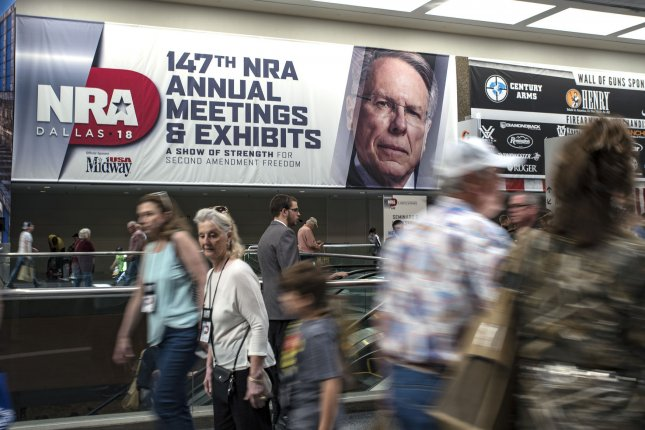 A sign promoting theNational Rifle Association and CEO Wayne LaPierre is seen at the annual convention in Dallas, Texas, on May 5, 2018. File Photo by Sergio Flores/UPI
