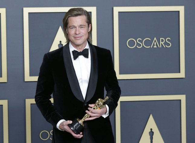 Brad Pitt, winner of Best Actor in a Supporting Role for Once Upon A Time In Hollywood, arrives backstage with his Oscar during the 92nd annual Academy Awards in Los Angeles in 2020. File Photo by John Angelillo/UPI