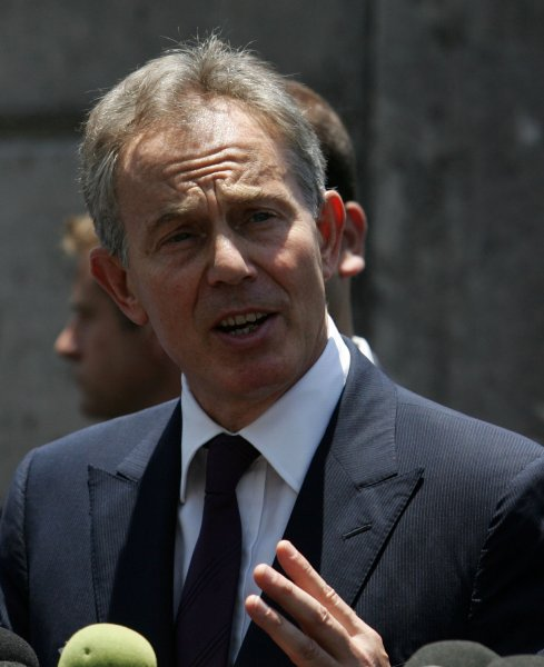 Former United Kingdom Prime Minister and International Quartet envoy to the Middle East Tony Blair (C) addresses to media upon his arrival at the United Nation compound in Gaza City, 15 June 2009.(UPI Photo/Ismael Mohamad)