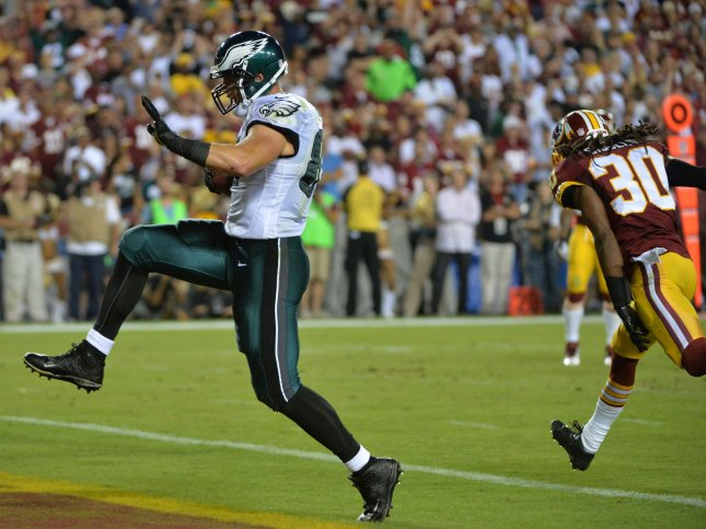 Philadelphia Eagles Brent Celek brings in a 28 yard touchdown against Washington Redskins cornerback E.J. Biggers (30) during the second quarter at FedEx Field in Landover, Maryland on September 9, 2013. UPI/Kevin Dietsch