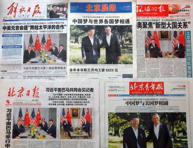 China's top newspapers feature front-page stories on Chinese President Xi Jinping's meeting with U.S. President Barack Obama in California yesterday, on June 9, 2013. China and the United States will increase comprehensive exchanges as the countries commit to building a new relationship for the future, the presidents of the world's two largest economies said during their meeting. UPI/Stephen Shaver