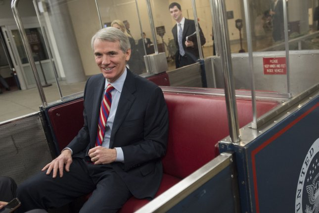 Sen. Rob Portman (R-OH) rides a subway to his office. UPI/Kevin Dietsch