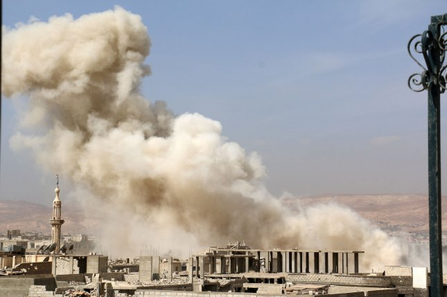 Smoke rises after airstrikes by the Syrian regime in the suburb of Daryya, near Damascus, Syria, on Oct. 12, 2015. Photo by Hossam Alahamad/ UPI