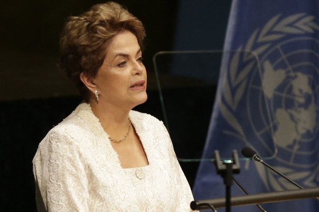 Brazilian President Dilma Rousseff, who is suspended over allegations she covered up federal budget gaps with funds from state-owned banks during an election year, will face a Senate vote on Tuesday that will decide if an impeachment trial will begin. A special committee on impeachment voted to continue impeachment proceedings against Rousseff on Thursday. File Photo by John Angelillo/UPI