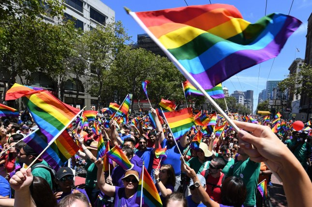 Marchers wave rainbow flags during a gay pride parade in San Francisco last year. In Kentucky, an appeals court ruled in favor of a T-shirt store owner who refused to print shirts for the Lexington gay pride festival because it went against his religious beliefs. File Photo by Terry Schmitt/UPI