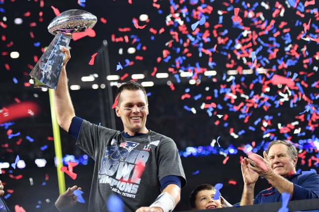 New England Patriots quarterback Tom Brady lifts the Vince Lombardi Trophy after winning Super Bowl LI in February 2017. File photo by Kevin Dietsch/UPI