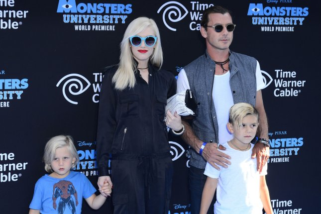 Gavin Rossdale (R) with Gwen Stefani and their sons at the Los Angeles premiere of Monsters University on June 17, 2013. Rossdale shared a first photo with Sophia Thomalla on Sunday following his split from Stefani. File Photo by Jim Ruymen/UPI
