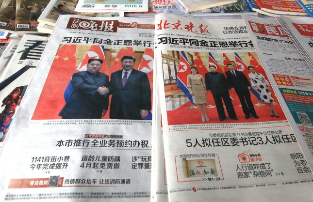 Several of China's top state-controlled newspapers, featuring a front page story of Chinese President Xi Jinping meeting with North Korean leader Kim Jong Un, are sold at a news kiosk in Beijing on March 28. Photo by Stephen Shaver/UPI