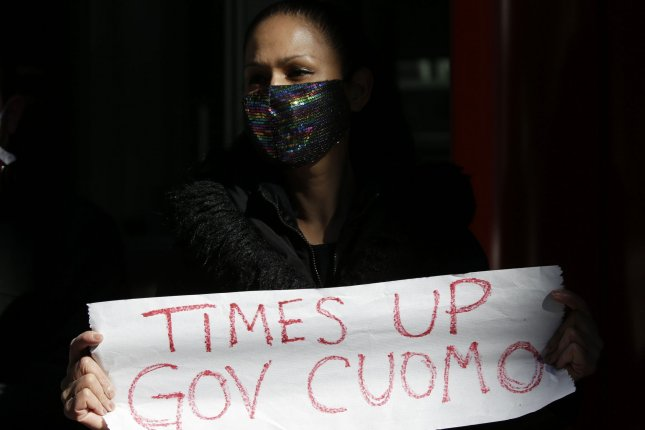 A protester holds up a sign that reads TIMES UP GOV. CUOMO outside of the Manhattan office of New York Gov. Andrew Cuomo. Photo by John Angelillo/UPI