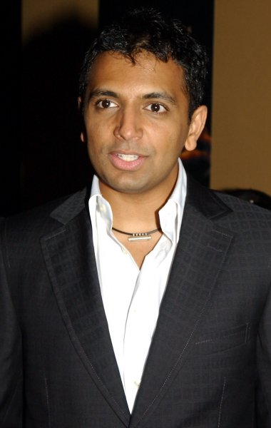 Director/writer M. Night Shyamalan attends the July 26, 2004 New York premiere of his new film The Village (UPI Photo/Ezio Petersen)