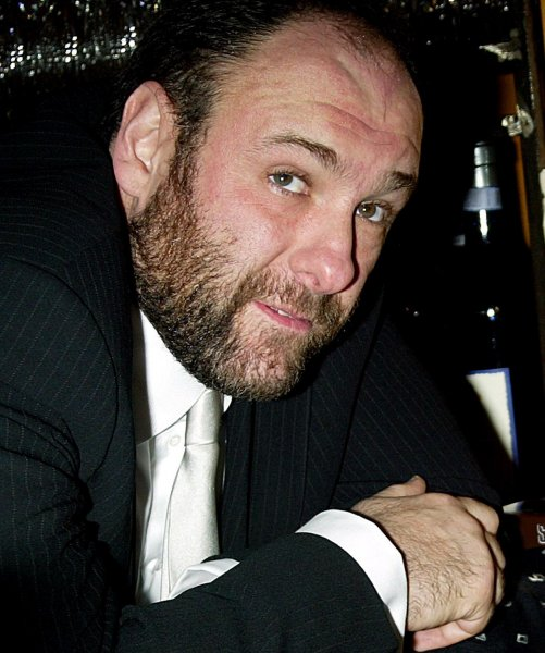 James Gandolfini died of a heart attack at the age of 51 while vacationing with his son in Rome, Italy on June 20, 2013. Gandolfini rose to stardom as the Mafia-boss character Tony Soprano. He is shown in 2002 file photo at the American Park Restaurant in New York. UPI/Laura Cavanaugh/files