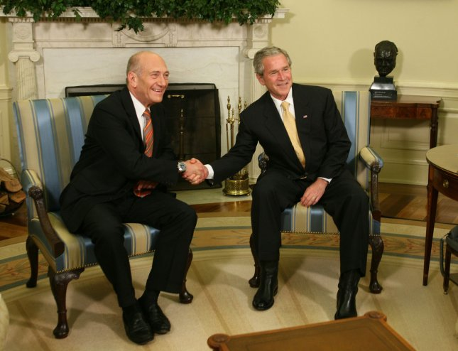 United States President George W. Bush (right) shakes hands with Israel's Prime Minister Ehud Olmert (left) in the Oval Office of The White House in Washington on June 4, 2008. (UPI Photo/Chris Kleponis/POOL)