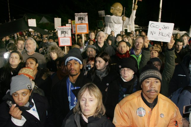 Protesters gathered at the gates of San Quentin Prison during the execution of Stanley Tookie Williams on Dec. 13, 2005. 005. Williams was one of a handful of people put to death in California in recent years. (UPI Photo/Terry Schmitt)