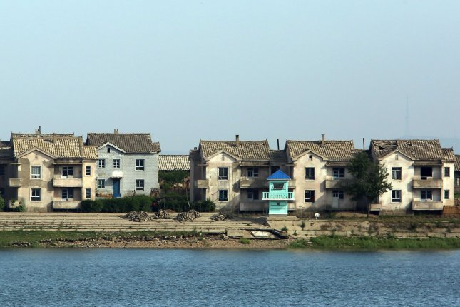 A North Korean guard tower, next to dilapidated houses, guards the border near the North Korean city Sinuiju, across the Yalu River from Dandong, China's largest border city with North Korea. A building in Pyongyang collapsed due to overdeployment of manpower on site, a source on North Korea told South Korea press Thursday. File Photo by Stephen Shaver/UPI