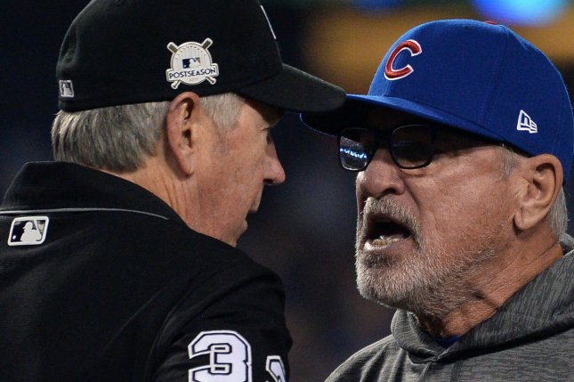 Chicago Cubs manager Joe Maddon argues overturned play at the plate against the Los Angeles Dodgers in the seventh inning with home plate umpire Lance Barksdale in Game 1 of the NLCS on Saturday at Dodgers Stadium in Los Angeles. Photo by Jim Ruymen/UPI