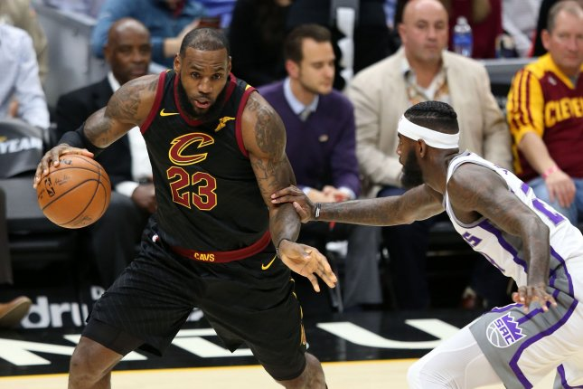 Cleveland Cavaliers forward LeBron James looks to make a move past Sacramento Kings defender Buddy Hield during the first half on December 6, 2017 at Quicken Loans Arena in Cleveland. File photo by Aaron Josefczyk/UPI