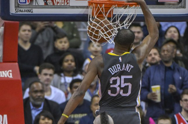 Golden State Warriors forward Kevin Durant (35) scores on a fast break in the first half against Washington Wizards center Marcin Gortat (13) on February 28 at Capital One Arena in Washington, D.C. Photo by Mark Goldman/UPI