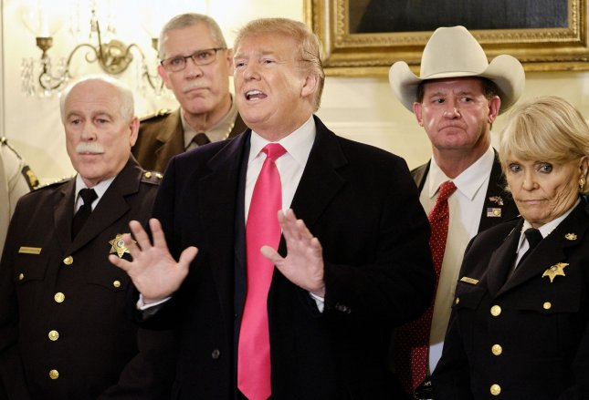 U.S. President Donald Trump speaks to the press alter meeting with sheriffs from across the country before departing for a rally in Texas, in the Diplomatic Reception Room at the White House in Washington, D.C., Monday. Photo by T.J. Kirkpatrick/UPI