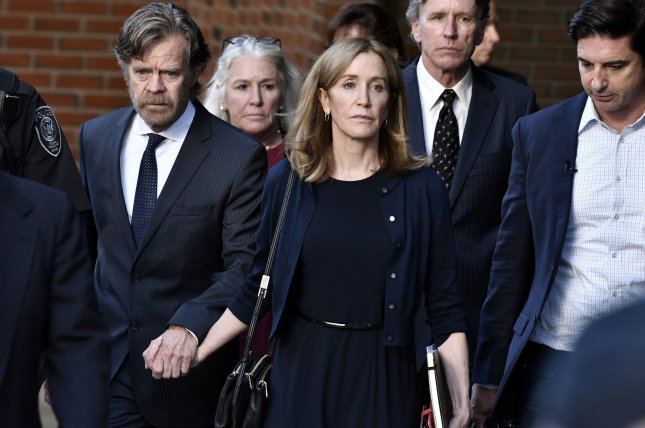 Actress Felicity Huffman leaves the courthouse in Boston, Mass., on September 13 after she was sentenced to serve 14 days in jail.  File Photo by Josh Reynolds/UPI