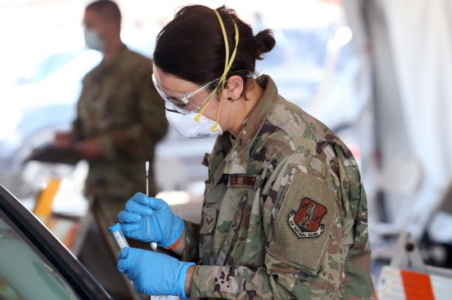 Members of the Illinois National Guard inspect test swabs at a COVID-19 testing site in East St. Louis, Ill., on May 28. The site is one of seven run by the Illinois National Guard. File Photo by Bill Greenblatt/UPI