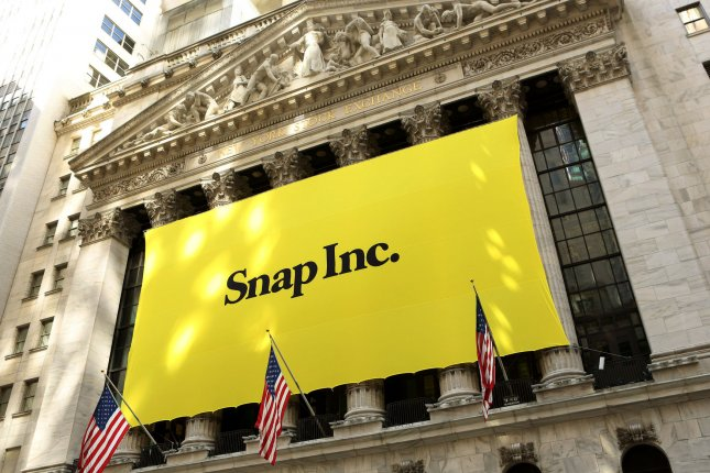 A banner with the Snap Inc. logo hangs in front of the New York Stock Exchange during the company's initial public offering, on March 2, 2017, in New York City. File Photo by Monika Graff/UPI