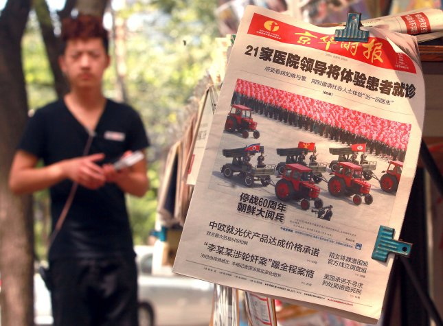 A Chinese state newspaper featuring a front-page story on North Korea's military parade celebrating the 60th anniversary of the end of the Korean War is sold at a newsstand in Beijing on July 29, 2013. North Korea marked the anniversary of the truce with a lavish military parade, including tractors pulling missiles, through Pyongyang's main square. UPI/Stephen Shaver