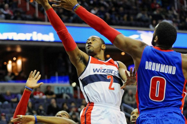 Washington Wizards point guard John Wall (2) scores against Detroit Pistons center Andre Drummond (0) in the first half at the Verizon Center in Washington, D.C. on January 18, 2014. UPI/Mark Goldman