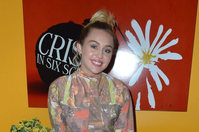 Miley Cyrus poses at The Crisis in Six Scenes premiere at The Crosby Street Hotel in New York City on September 15, 2016. Cyrus recently hosted an episode of Ellen in place of a sick Ellen DeGeneres. Photo by Andrea Hanks/UPI