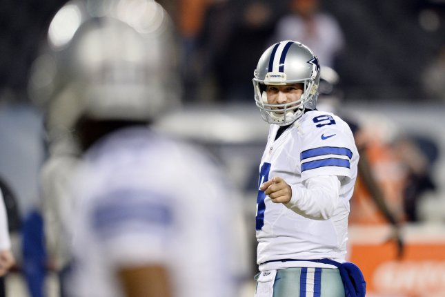 Dallas Cowboys quarterback Tony Romo gets ready to throw a pass during warmups before a December 4, 2014, game against the Chicago Bears at Soldier Field. Romo is retiring from football and is interested in taking a broadcasting job. File photo by Brian Kersey/UPI