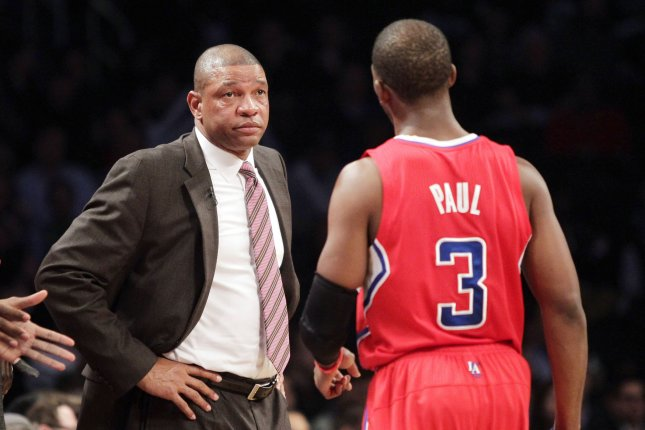 Los Angeles Clippers head coach Doc Rivers stands near Chris Paul. File photo by John Angelillo/UPI