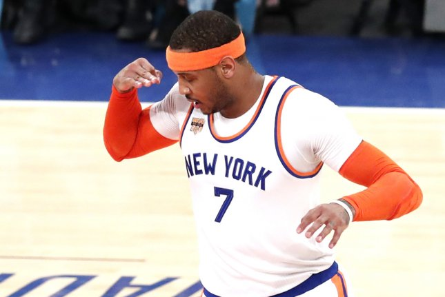 New York Knicks Carmelo Anthony reacts after hitting a 3-point shot in the first half against the Charlotte Hornets at Madison Square Garden in New York City on January 27, 2017. The Knicks are actively trying to trade Anthony who has two years and almost $53 million remaining on his contract. Photo by John Angelillo/UPI
