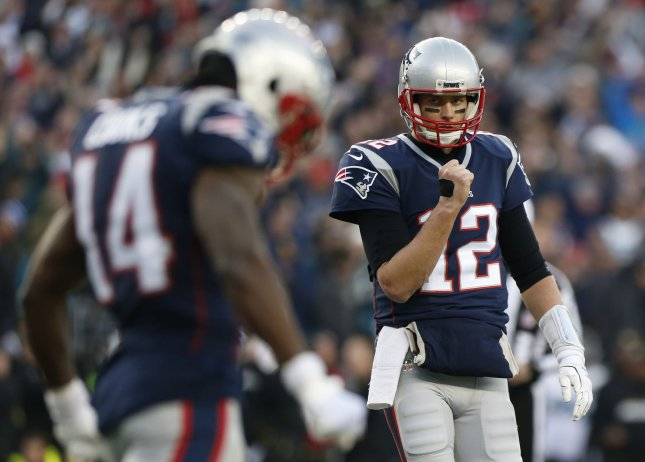 New England Patriots quarterback Tom Brady pumps his fist after the Patriots scored on a short run against the Jacksonville Jaguars during the AFC Championship game Jan. 21. Photo by Matthew Healey/ UPI