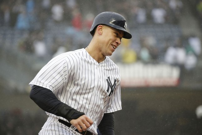 New York Yankees outfielder Aaron Judge rounds third base after Didi Gregorius hits a 3-run home run in the third inning against the Tampa Bay Rays in the Yankees home opener Tuesday at Yankee Stadium in New York City. Photo by John Angelillo/UPI